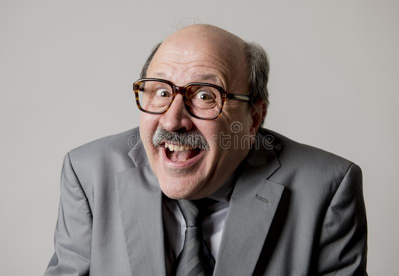 Portrait of happy and cheerful senior mature 60s business man smiling wearing dressing formal necktie looking cheerful and excited stock image