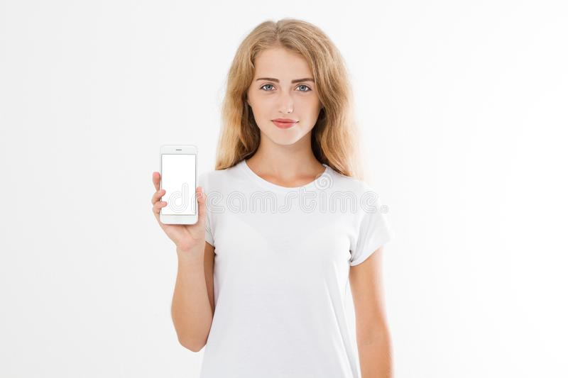 Portrait of a happy cheery teenage girl dressed in white t-shirt holding blank screen mobile phone royalty free stock photo
