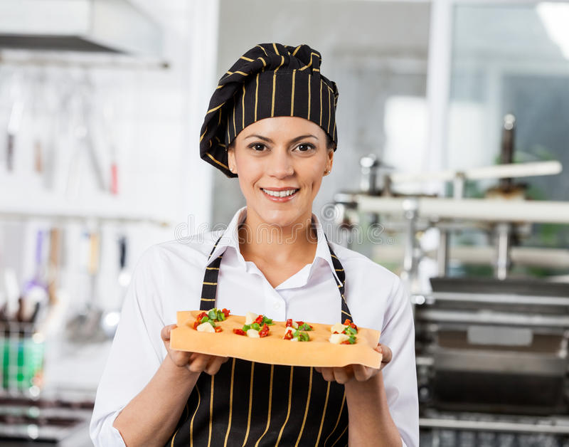 Portrait Of Happy Chef Holding Tray With Stuffed royalty free stock photography