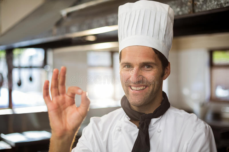 Portrait of happy chef making ok sign royalty free stock photos