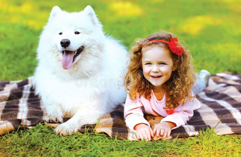 Portrait happy child and dog having fun stock photography
