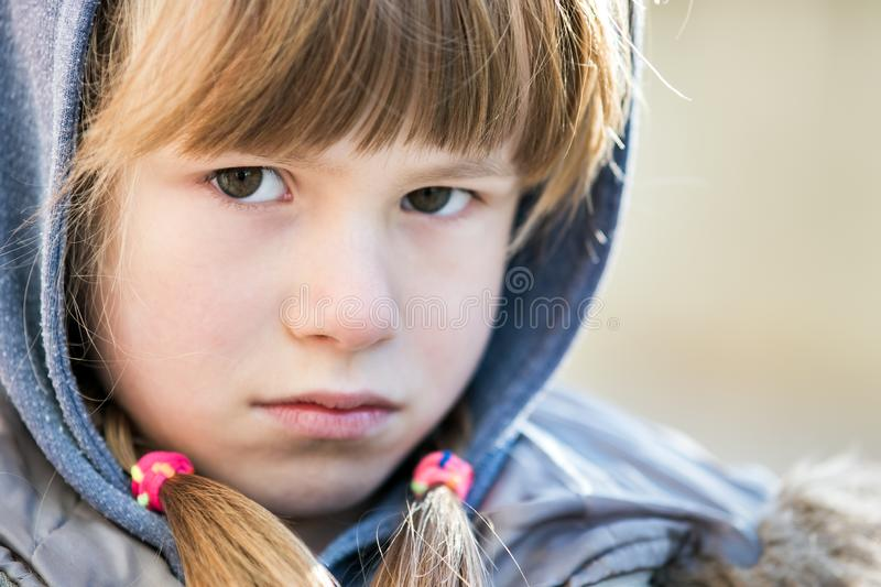 Portrait of happy child girl in warm clothes in autumn outdoors royalty free stock photos