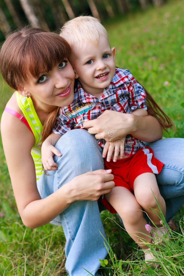 Portrait Of A Happy Child And Mom In A Summer Park Royalty Free Stock Image