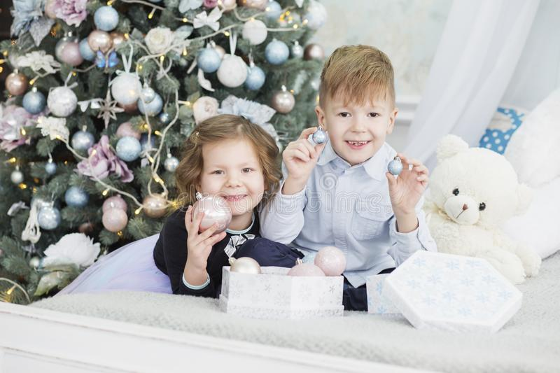 Portrait of a happy children - boy and girl. Little kids in Christmas decorations. Brother and sister stock photo