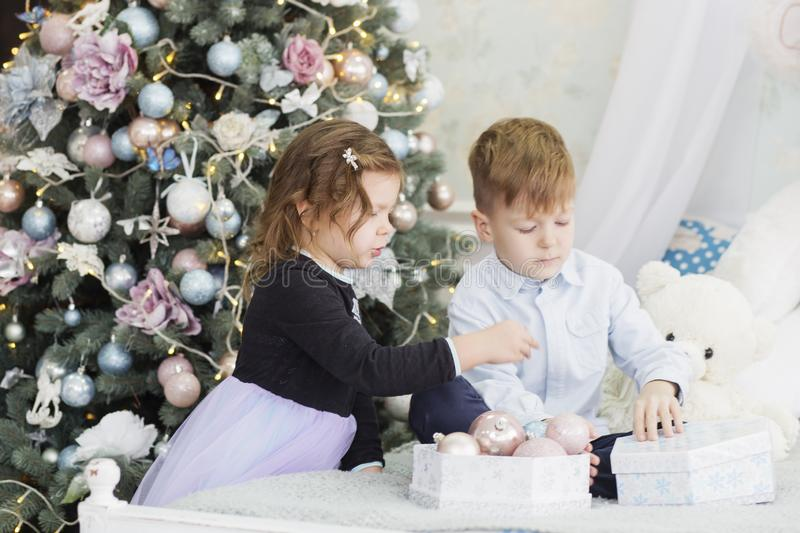 Portrait of a happy children - boy and girl. Little kids in Christmas decorations. Brother and sister stock image