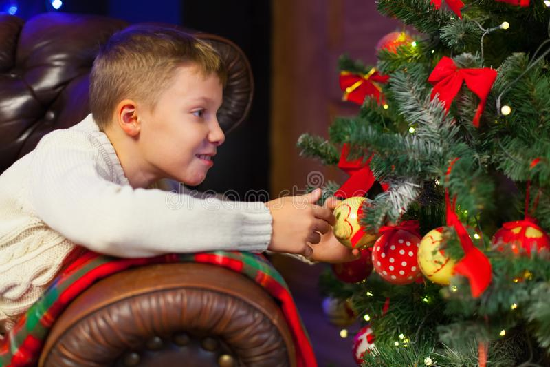 Portrait of happy children decorating Christmas tree.Family, chr. Istmas, winter,happiness and people concept stock photos