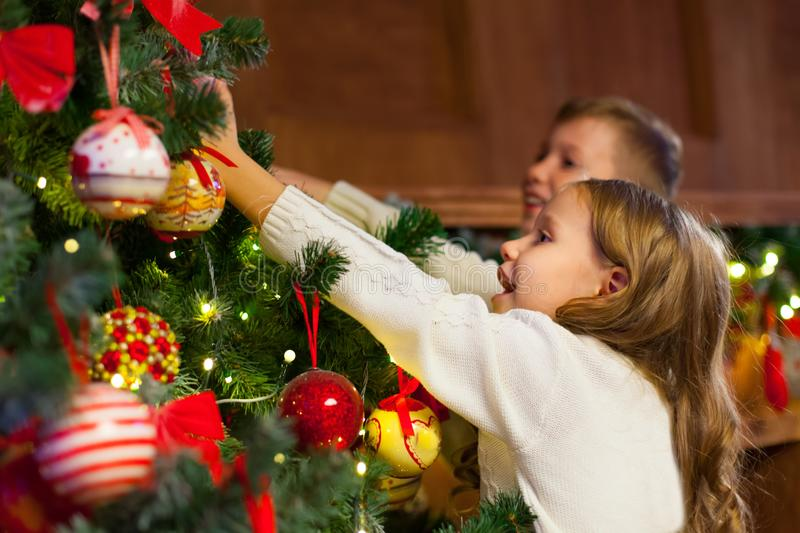 Portrait of happy children decorating Christmas tree.Family, chr. Istmas, winter,happiness and people concept royalty free stock photography