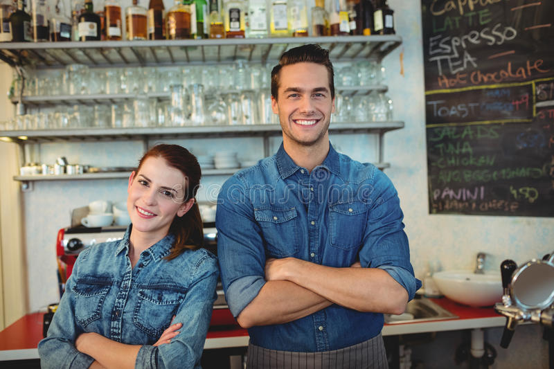 Portrait of happy co-workers at cafeteria. Portrait of happy young co-workers at cafeteria stock image