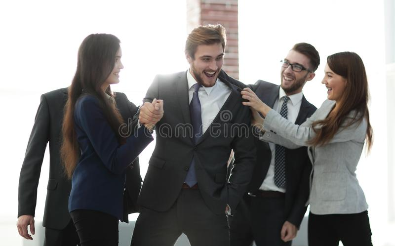 Portrait of a professional business team celebrate their victory royalty free stock image