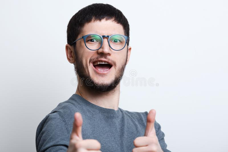 Portrait of happy confident young man showing thumbs up royalty free stock image