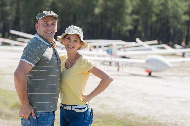Portrait happy couple at airfield royalty free stock images