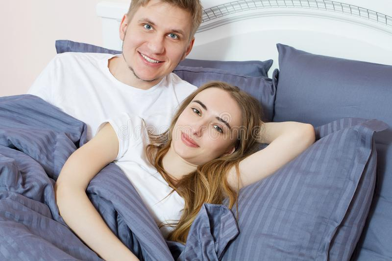Portrait Happy couple bed bedroom in the morning, happy family, healthy sleep concept.  royalty free stock photo