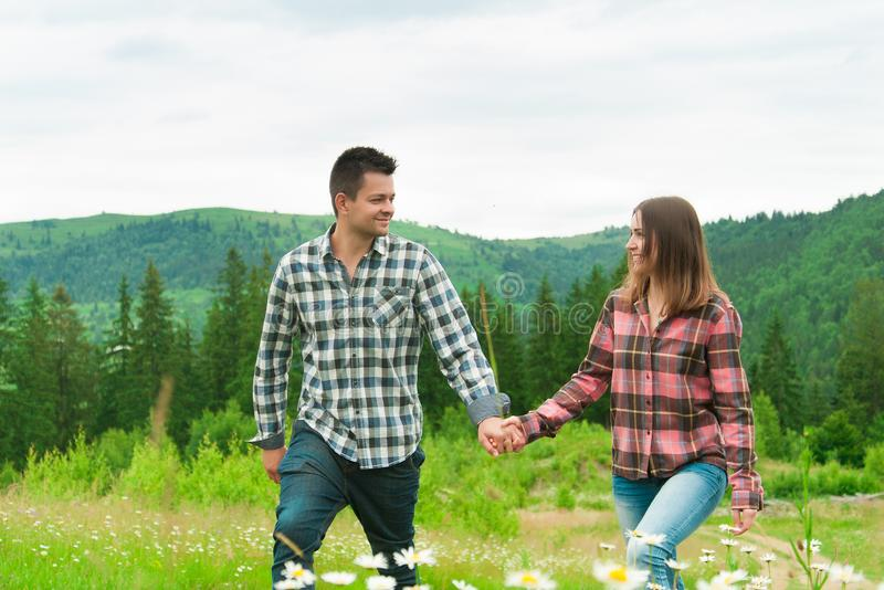Loving couple having fun on summer vacation. Portrait of a happy couple having fun in mountains.Young couple in love outdoors. Summer holidays, love stock photos