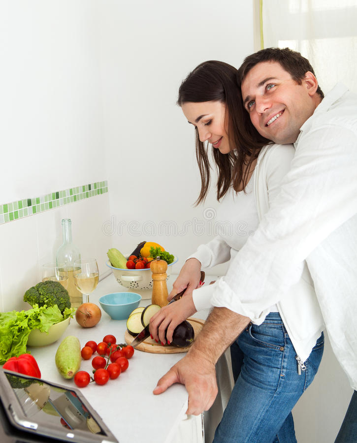 Download Portrait Of A Happy Couple In The Kitchen Stock Photo - Image: 27618104