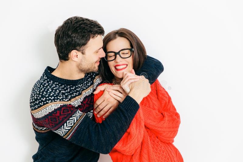 Portrait of happy couple in love embrace each other, have positive smiles, date and meet after not seeing long time, isolated stock photo