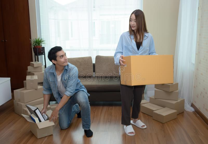 Portrait of a happy couple packing boxes in a new house Into New. Home On Moving Day royalty free stock image
