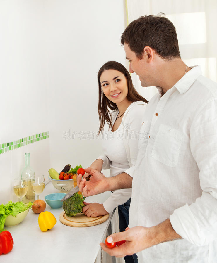 Download Portrait Of A Happy Couple Preparing Food Stock Photo - Image: 27618098