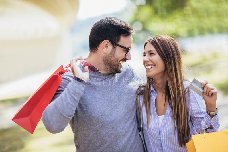 Portrait of happy couple with shopping bags after shopping in ci royalty free stock photos