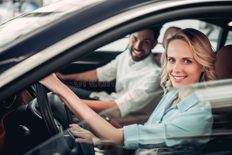 Couple sitting in new car royalty free stock photo