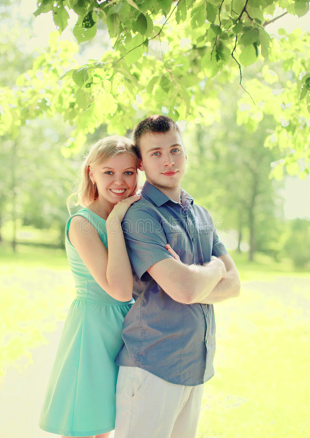 Portrait happy couple walking together at summer. Park royalty free stock images