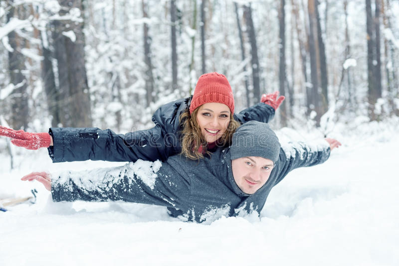 Portrait of happy couple in winter park royalty free stock photography