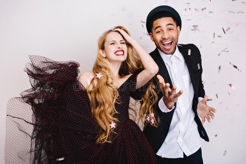 Portrait happy crazy emotions on celebration Valentine day of excited couple in love having fun white background. Luxury stock photo