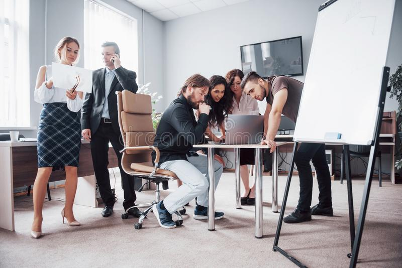 Portrait of a happy creative team of people talking in the office at the meeting. royalty free stock photos
