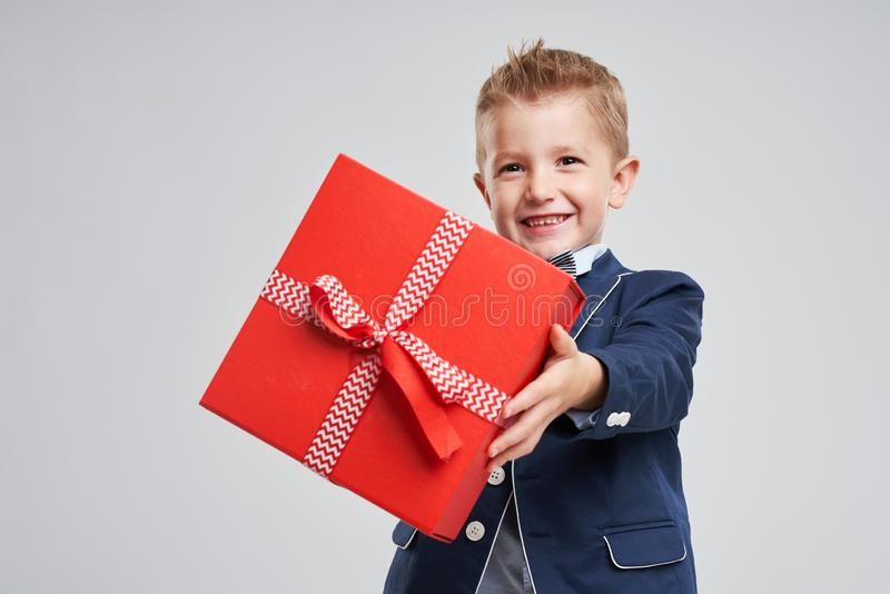 Portrait of happy cute little kid holding gift stock images