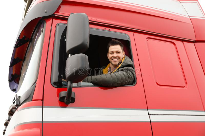 Portrait of happy driver in cab of truck. Portrait of happy driver in cab of modern truck royalty free stock photos
