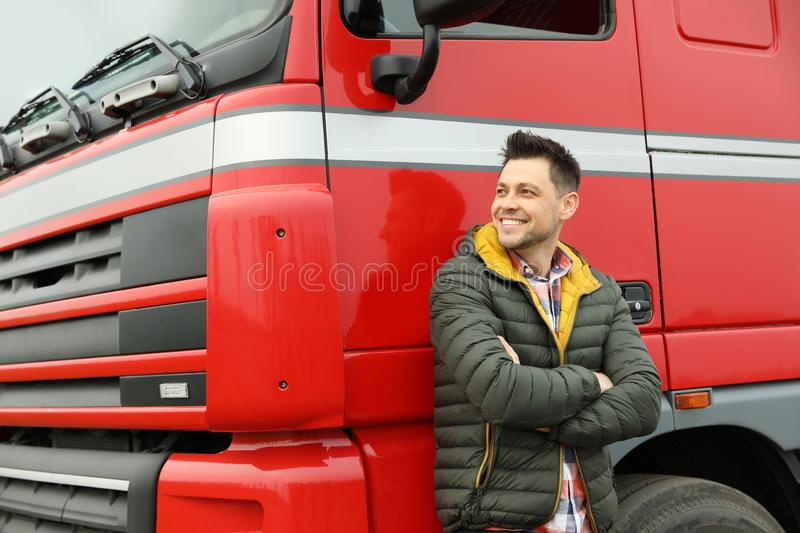 Portrait of happy driver at modern truck. Outdoors royalty free stock image
