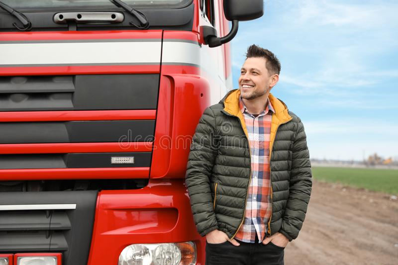 Portrait of happy driver at modern truck outdoors. Space for text royalty free stock photo