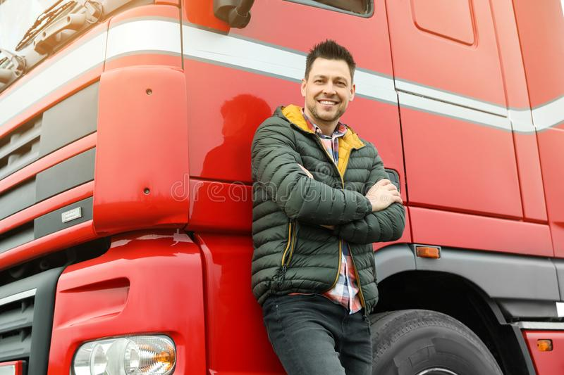 Portrait of happy driver at modern truck. Outdoors royalty free stock photos