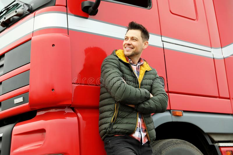 Portrait of happy driver at modern truck. Outdoors royalty free stock images