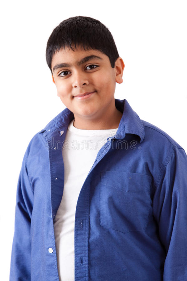 Portrait of a happy east indian teenager. Isolated portrait of a happy east indian teenage boy stock photography