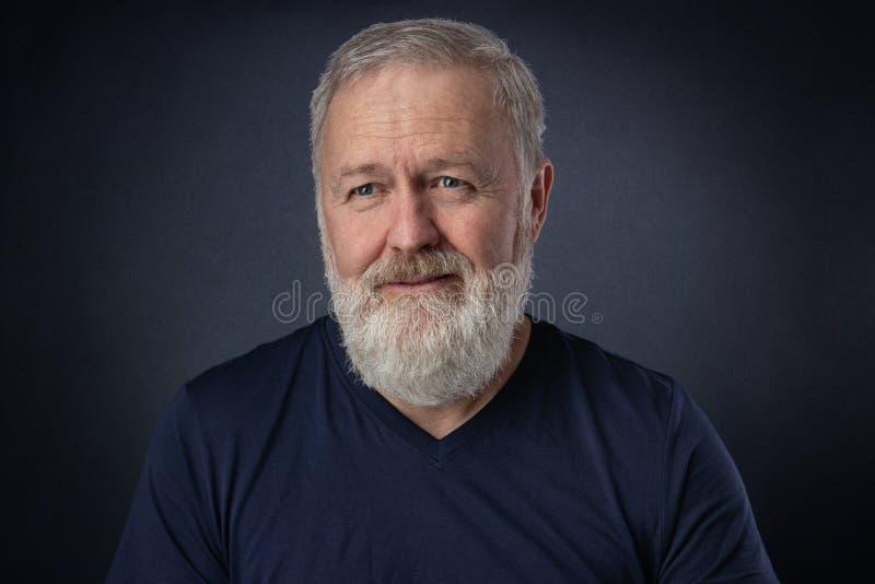 Portrait of a happy elderly man stock images