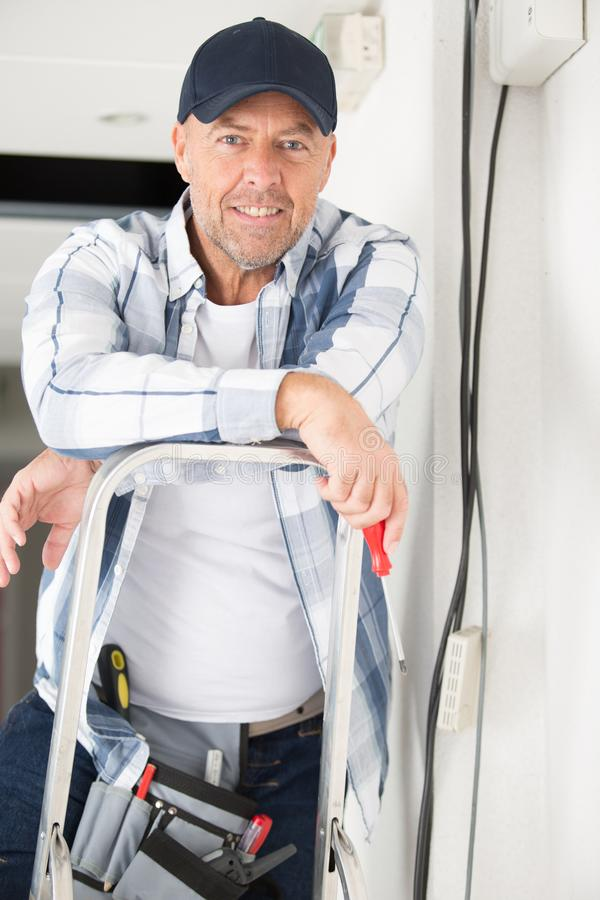 Portrait happy electrician smiling at camera royalty free stock photography