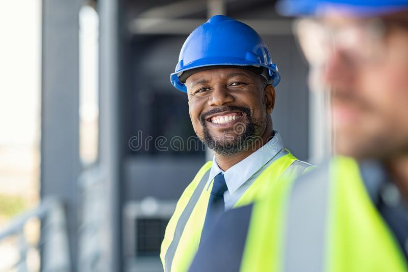 Portrait of happy engineer on site stock images