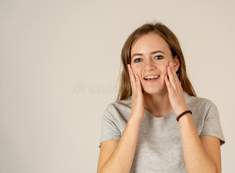 Portrait of happy excited beautiful teenager woman with happy facial expression royalty free stock photo