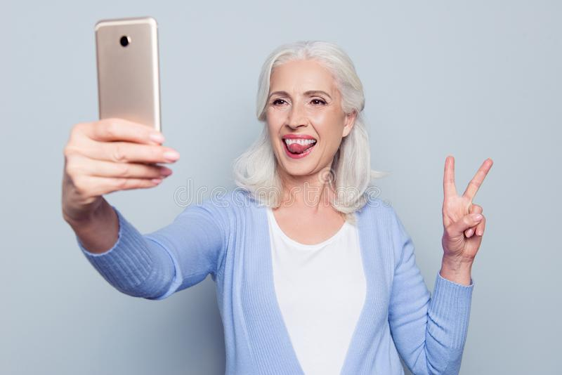Portrait of happy excited cheerful joyful funny grandmother gran royalty free stock photo