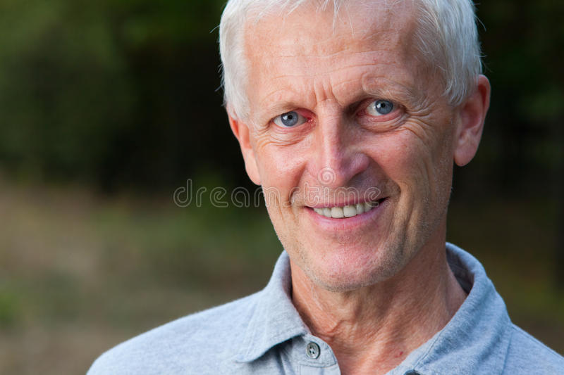 Portrait of happy face of grey-haired old man stock photos