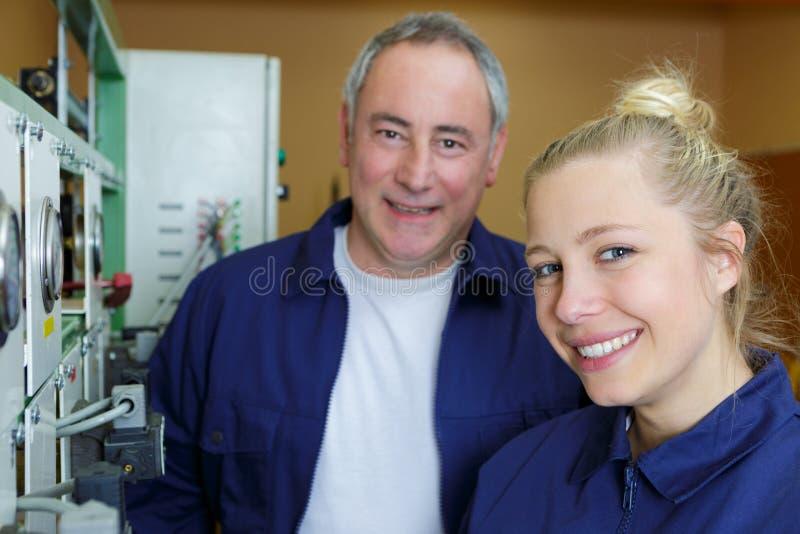 Portrait happy factory workers. A portrait of happy factory workers royalty free stock images