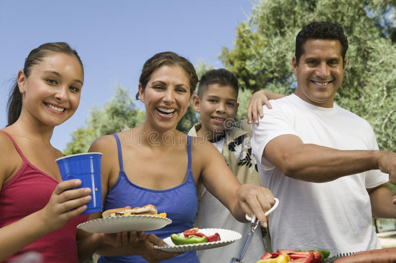 Portrait Of Happy Family Around The Grill At Picnic royalty free stock photos
