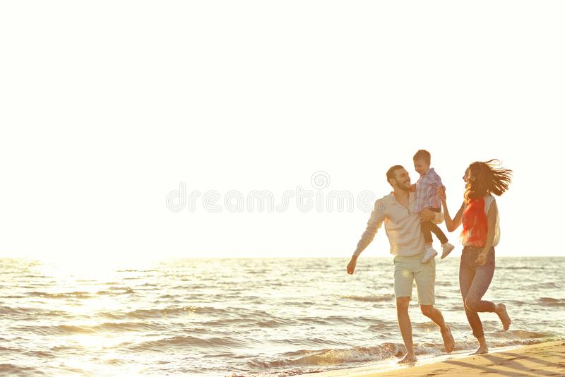 Portrait of happy family and baby enjoying sunset in the summer leisure stock image