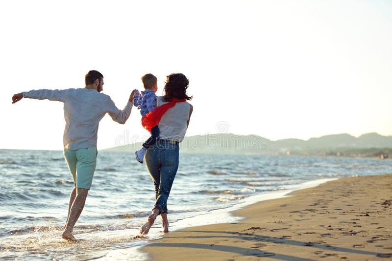 Portrait of happy family and baby enjoying sunset in the summer leisure stock images