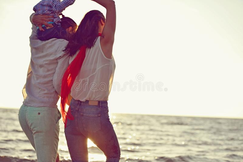 Portrait of happy family and baby enjoying sunset in the summer leisure royalty free stock photography
