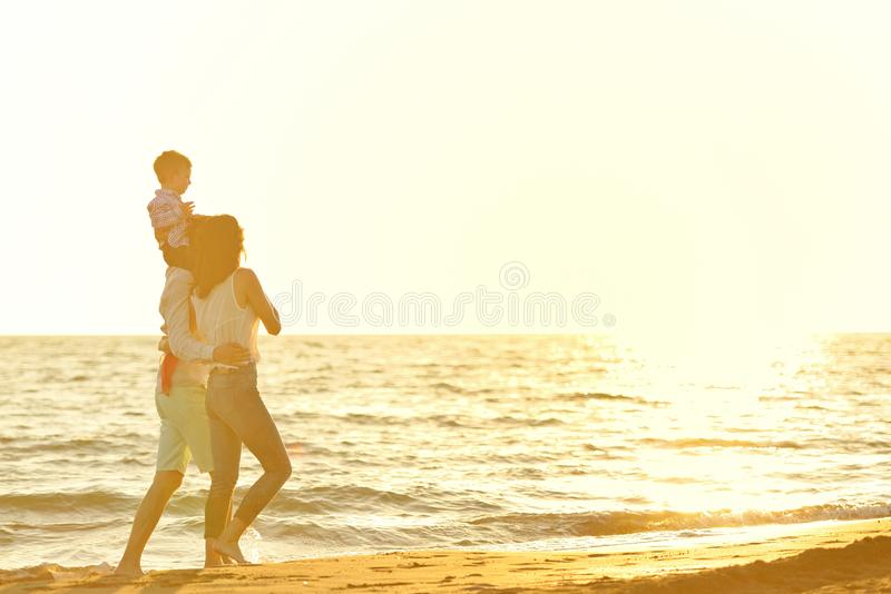 Portrait of happy family and baby enjoying sunset in the summer leisure stock photos