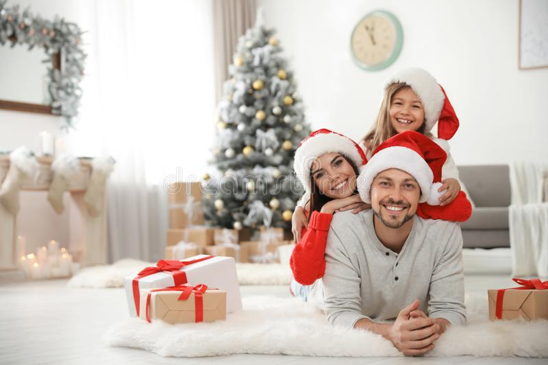 Portrait of happy family with Christmas gifts on floor royalty free stock photos
