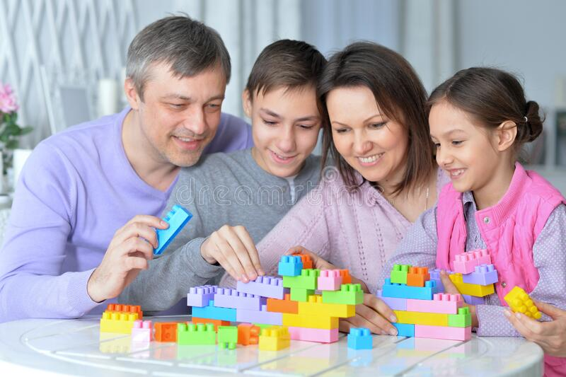 Portrait of happy family collecting colorful blocks royalty free stock photos