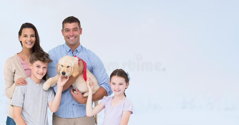 Portrait of happy family with dog against gray background royalty free stock photography