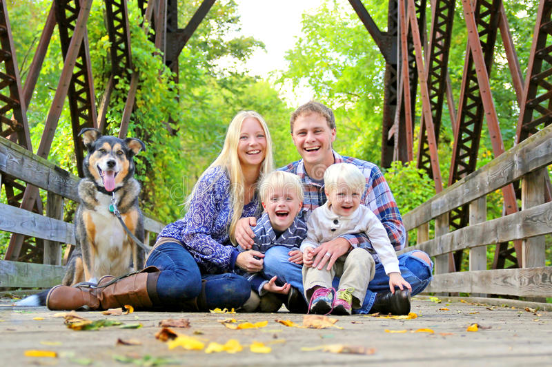 Portrait of Happy Family and Dog Outside in Fall royalty free stock images